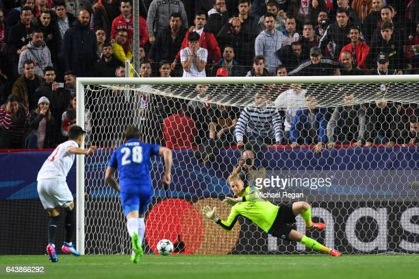Kasper Schmeichel of Leicester City saves a penalty from Joaquin Correa of Sevilla during the UEFA Champions League Round of 16 first leg match...