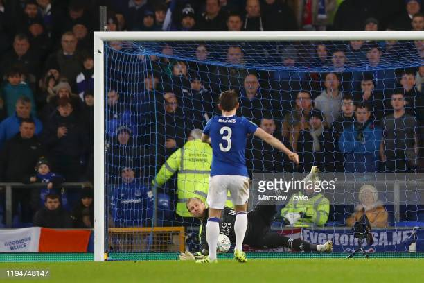 Kasper Schmeichel of Leicester City saves a penalty from Leighton Baines of Everton during the Carabao Cup Quarter Final match between Everton FC and...