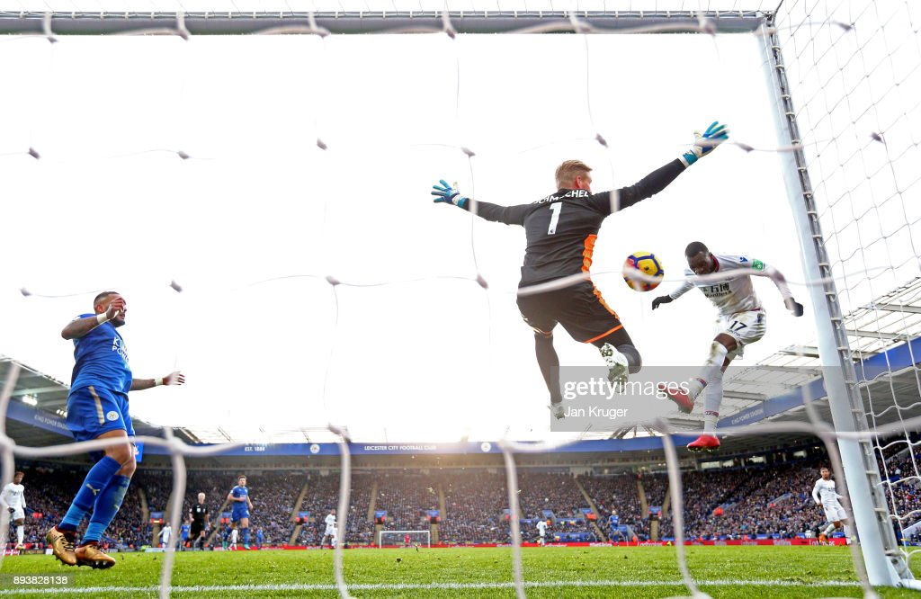 Kasper Schmeichel of Leicester City saves from Christian Benteke of Crystal Palace during the Premier League match between Leicester City and Crystal Palace at The King Power Stadium on December 16, 2017 in Leicester, England.