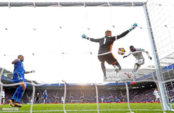 Kasper Schmeichel of Leicester City saves from Christian Benteke of Crystal Palace during the Premier League match between Leicester City and Crystal...