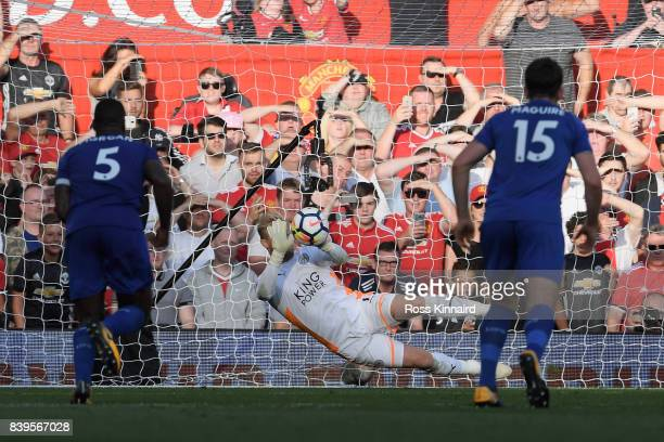 Kasper Schmeichel of Leicester City saves Romelu Lukaku of Manchester United penalty during the Premier League match between Manchester United and...