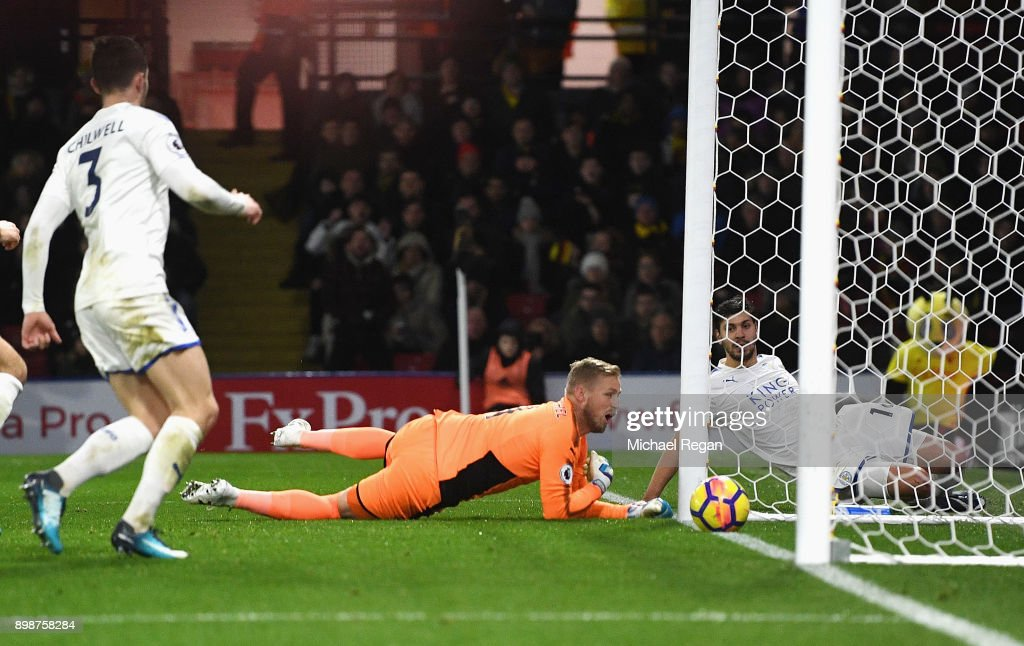 Kasper Schmeichel of Leicester City scores an own goal during the Premier League match between Watford and Leicester City at Vicarage Road on December 26, 2017 in Watford, England.
