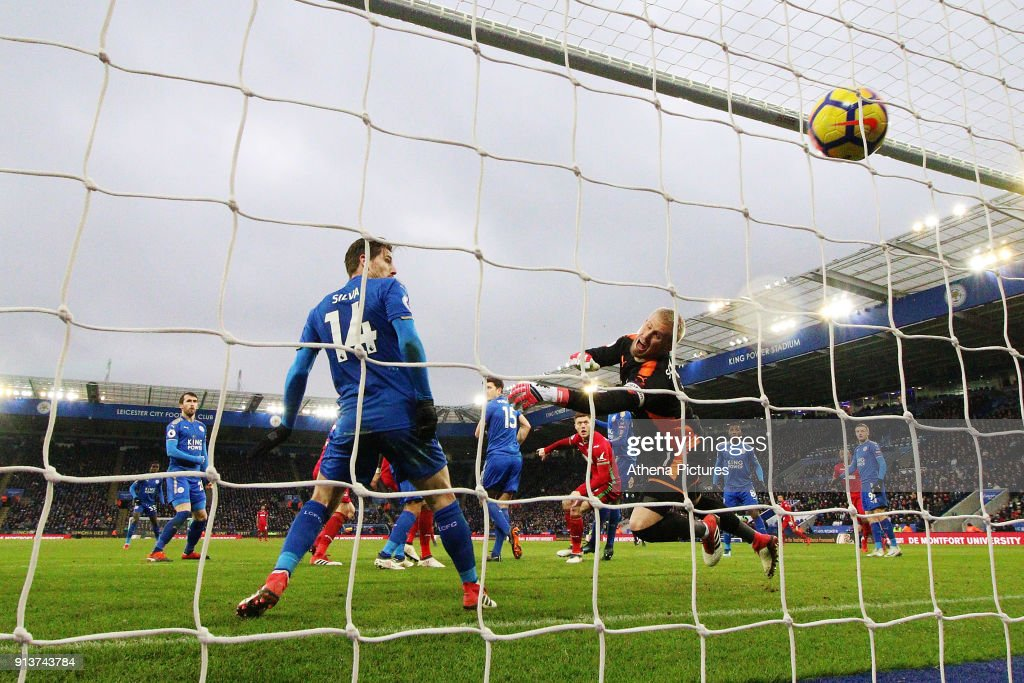 Kasper Schmeichel of Leicester City watches the ball go past him a Federico Fernandez of Swansea scores his sides first goal of the match to equalise during the Premier League match between Leicester City and Swansea City at the Liberty Stadium on February 3, 2018 in Leicester, England.