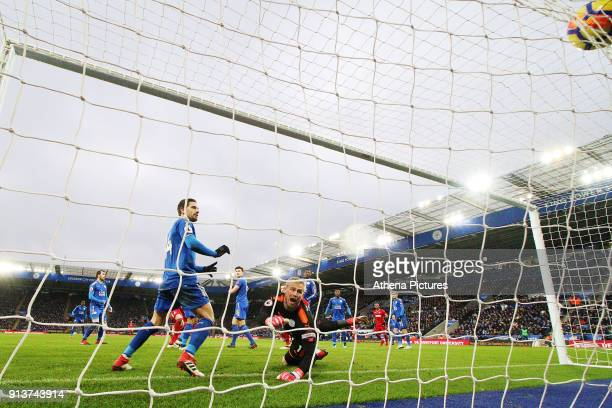 Kasper Schmeichel of Leicester City watches the ball go past him a Federico Fernandez of Swansea scores his sides first goal of the match to equalise...