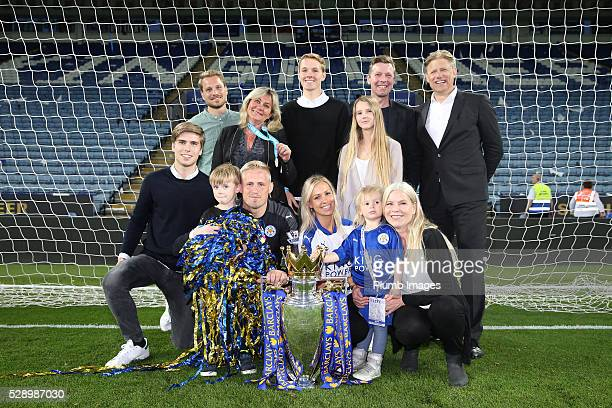 Kasper Schmeichel of Leicester City with his family including his dad Peter Schmeichel and the Premier League trophy at the King Power Stadium on May...