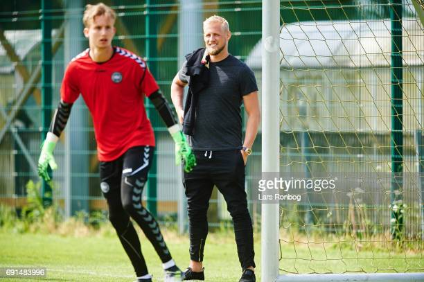 Kasper Schmeichel watching colleague Frederik Ronnow in action during to the Denmark training session at Brondby Stadion on June 2 2017 in Brondby...