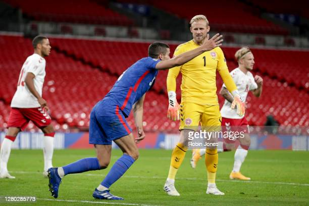 Kasper Schmeichelof Denmark doesnt agree as Conor Coady of England appeals for a second half penalty during the UEFA Nations League group stage...