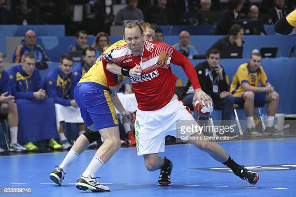 Kasper Sondergaard of Denmark is trying to shoot the ball against Jim Gottfridsson of Sweden during the 25th IHF Men's World Championship 2017 match...