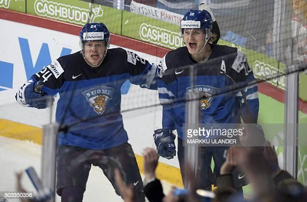 Kasperi Kapanen and Roope Hintz of Finland celebrate after Hintz scored 11 during the 2016 IIHF World Junior Ice Hockey Championship semifinal match...