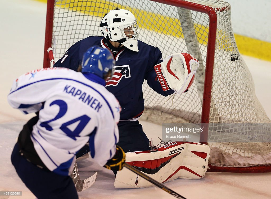 Kasperi Kapanen #24 of Team Finland scores against Brendan Burke #31 of USA Blue during the 2014 USA Hockey Junior Evaluation Camp at the Lake Placid Olympic Center on August 3, 2014 in Lake Placid, New York. USA Blue defeated Team Finland 2-1.