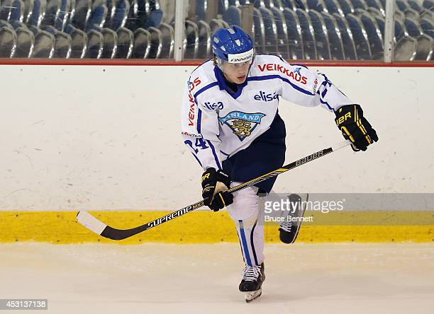 Kasperi Kapanen of Team Finland skates against USA Blue during the 2014 USA Hockey Junior Evaluation Camp at the Lake Placid Olympic Center on August...