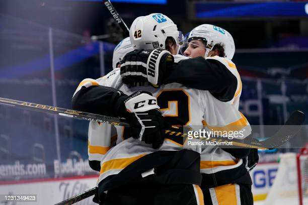 Kasperi Kapanen of the Pittsburgh Penguins celebrates with his teammates after scoring the game winning goal against the Washington Capitals in...