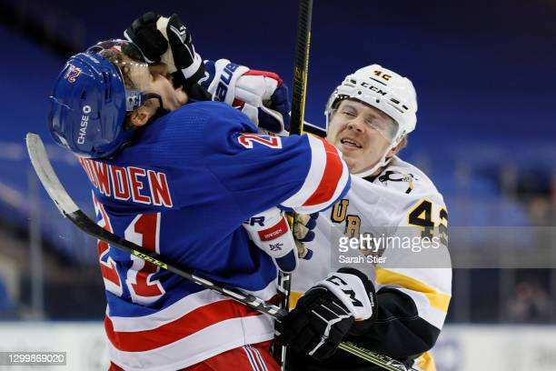 Kasperi Kapanen of the Pittsburgh Penguins fights Brett Howden of the New York Rangers during the first period at Madison Square Garden on February...