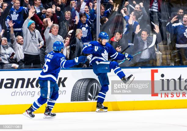 Kasperi Kapanen of the Toronto Maple Leafs celebrates his game winning goal against the Arizona Coyotes with teammate Alexander Kerfoot in overtime...