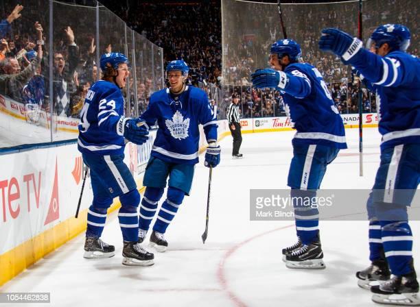 Kasperi Kapanen of the Toronto Maple Leafs celebrates his goal with teammates Nikita Zaitsev John Tavares and Zach Hyman during the third period...