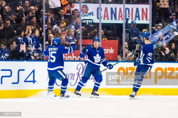 Kasperi Kapanen of the Toronto Maple Leafs celebrates his goals against the Pittsburgh Penguins with teammates Alexander Kerfoot and Pierre Engvall...