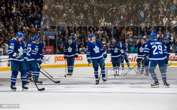 Kasperi Kapanen of the Toronto Maple Leafs celebrates with teammates after clinching playoff spot against the Pittsburgh Penguins during the third...