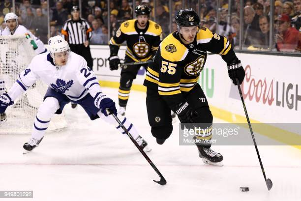Kasperi Kapanen of the Toronto Maple Leafs defends Noel Acciari of the Boston Bruins during the first period of Game Five of the Eastern Conference...