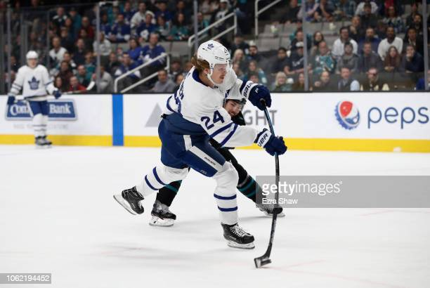 Kasperi Kapanen of the Toronto Maple Leafs gets past Logan Couture of the San Jose Sharks to score a goal at SAP Center on November 15 2018 in San...