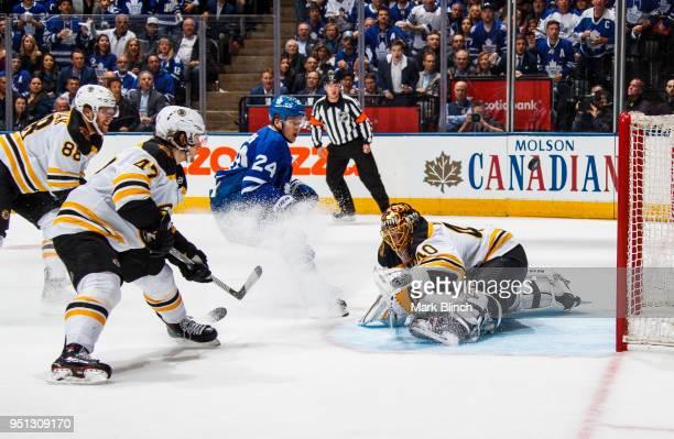 Kasperi Kapanen of the Toronto Maple Leafs goes to the net against Tuukka Rask Torey Krug and David Pastrnak of the Boston Bruins in Game Six of the...