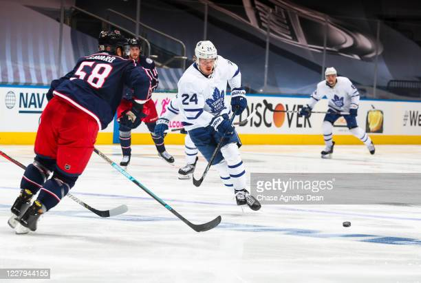 Kasperi Kapanen of the Toronto Maple Leafs plays the puck against the Columbus Blue Jackets during the third period in Game Three of the Eastern...
