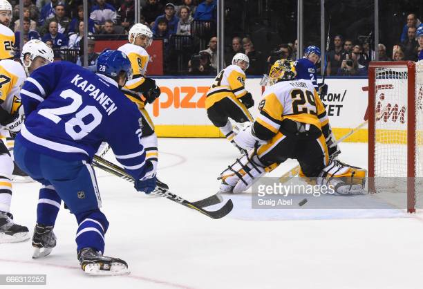 Kasperi Kapanen of the Toronto Maple Leafs scores his first NHL goal on MarcAndre Fleury of the Pittsburgh Penguinsduring the third period at the Air...