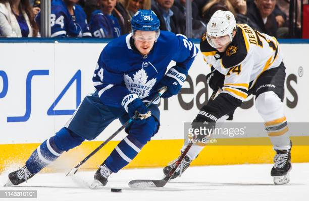 Kasperi Kapanen of the Toronto Maple Leafs skates against Jake DeBrusk of the Boston Bruins during the second period in Game Three of the Eastern...