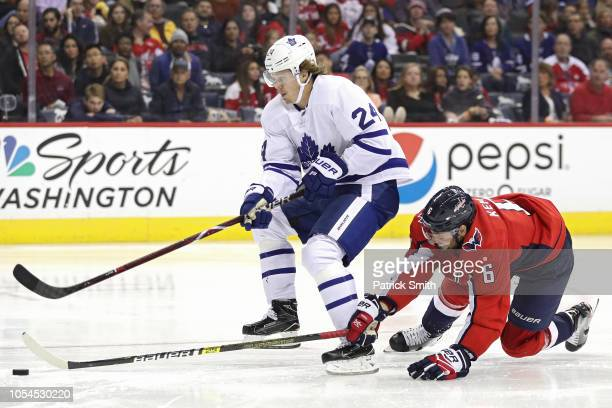Kasperi Kapanen of the Toronto Maple Leafs skates past Michal Kempny of the Washington Capitals during the third period at Capital One Arena on...