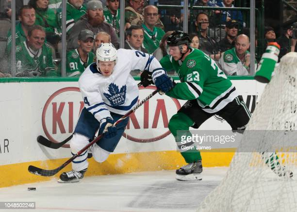 Kasperi Kapanen of the Toronto Maple Leafs tries to keep the puck away against Esa Lindell of the Dallas Stars at the American Airlines Center on...