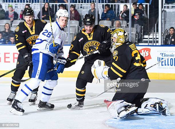 Kasperi Kapanen of the Toronto Marlies battles for the puck with Dan Vladar Jordan Szwarz and Alex Grant of the Providence Bruins during game action...