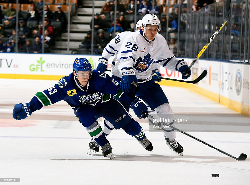 Kasperi Kapanen #28 of the Toronto Marlies battles for the puck with Tom Nilsson #43 of the Utica Comets during game action on November 26, 2016 at Air Canada Centre in Toronto, Ontario, Canada.