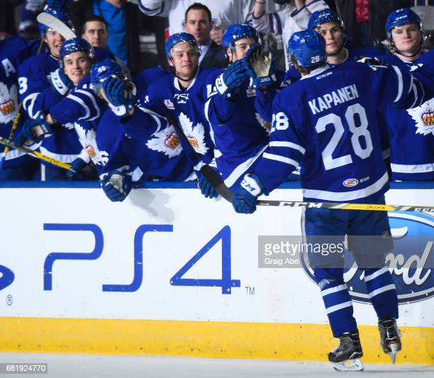 Kasperi Kapanen of the Toronto Marlies celebrates his goal with teammates against the Syracuse Crunch during game 3 action in the Division Final of...