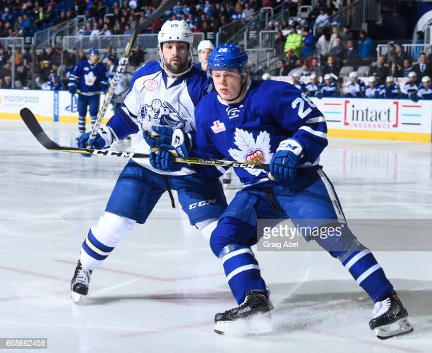 Kasperi Kapanen of the Toronto Marlies watches the play develop against Cory Conacher of the Syracuse Crunch during AHL game action on March 26 2017...