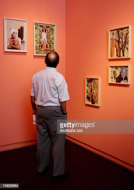 A visitor looks at works of the series Siegesgaerten by Austrian Artist Ines Doujak exhibited at the documenta 12 art fair 15 June 2007 in Kassel...