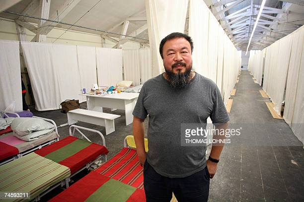 Chinese artist Ai Weiwei poses in front of his installation Fairytale consisting of bringing 1001 Chinese people to Kassel 14 June 2007 during the...