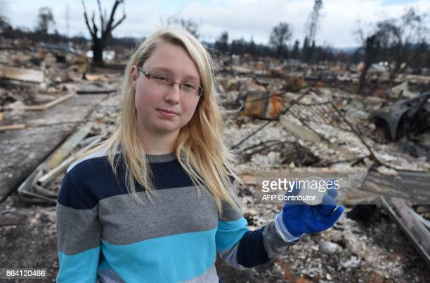 Kassidy Sharp holds part of a tea set given to her by her grandmother and found in the burned remains of her home in Santa Rosa California on October...