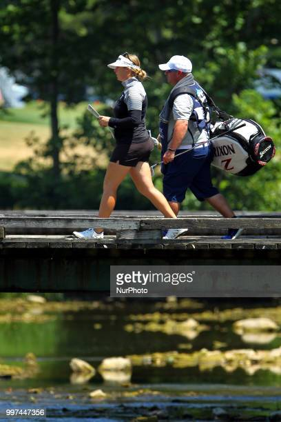 Kassidy Teare of San Diego CA crosses the bridge with her caddy toward the 2nd green during the first round of the Marathon LPGA Classic golf...