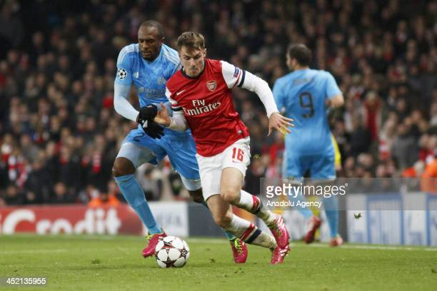 Kassim Abdallah of Marseille vies with Aaron Ramsey of Arsenal during the UEFA Champions League group F football match between Arsenal and Olympique...