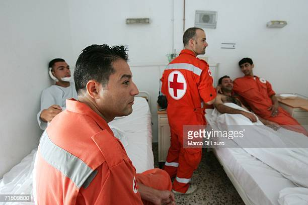 Kassim Chaalan 28yearsold and Mohammar Hassan 35yearsold of the Lebanese Red Cross are surrounded by their colleagues as they recover in their...
