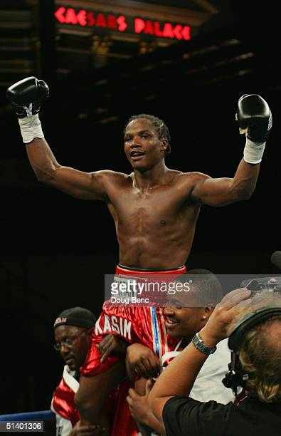 Kassim Ouma celebrates his victory over Verno Phillips for the IBF Junior Middleweight Championship at the Amphitheatre at Caesars Palace on October...