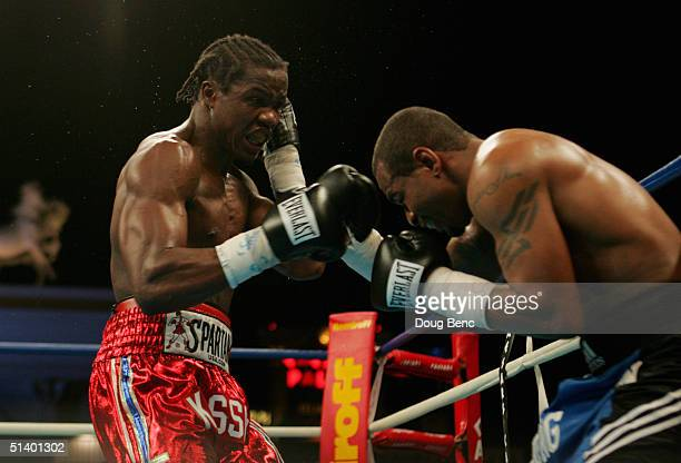Kassim Ouma forces Verno Phillips into the ropes during their fight for the IBF Junior Middleweight Championship at the Amphitheatre at Caesars...