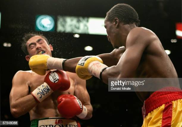 Kassim Ouma lands a right on Marco Antonio Rubio during their WBC middleweight bout on the undercard of the Ricardo MayorgaOscar De La Hoya fight at...