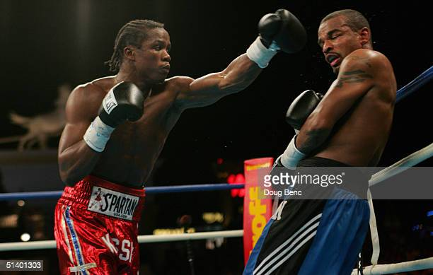 Kassim Ouma throws a left to forces Verno Phillips into the ropes during their fight for the IBF Junior Middleweight Championship at the Amphitheatre...