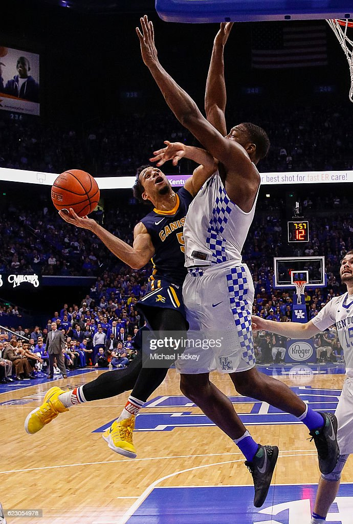 Kassius Robertson #5 of the Canisius Golden Griffins shoos the ball against Edrice Adebayo #3 of the Kentucky Wildcats at Rupp Arena Stadium on November 13, 2016 in Lexington, Kentucky. Kentucky defeated Canisius 93-69.