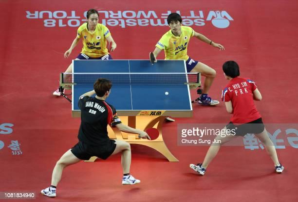 Kasumi Ishikawa and Maharu Yoshimura of Japan compete against Jang Woo-jin of South Korea and Cha Hyo-Sim of North Korea in the Mixed Doubles -...