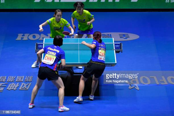 Kasumi Ishikawa and Miu Hirano of Japan compete against Chen Meng and Liu Shiwen of China during match 1 of the Women's team final on day five of the...