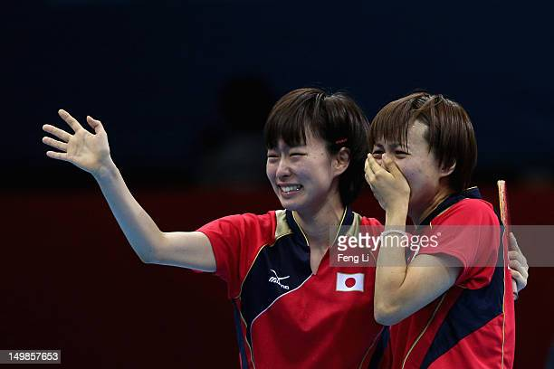 Kasumi Ishikawa and Sayaka Hirano of Japan celebrates during Women's Team Table Tennis semifinal match against team of Singapore on Day 9 of the...