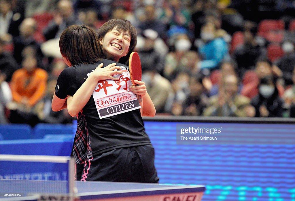 Kasumi Ishikawa celebrates with Sayaka Hirano after winning the match against Hiroko Nakagawa and Mika Tsuchida at All Japan Table Tennis Championships at Tokyo Gymnasium on January 19, 2014 in Tokyo, Japan.
