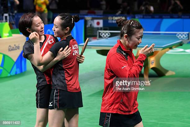 Kasumi Ishikawa Mima Ito and Ai Fukuhara of Japan celebrate winning the bronze medals after beating Singapore in the Table Tennis Women's Team bronze...
