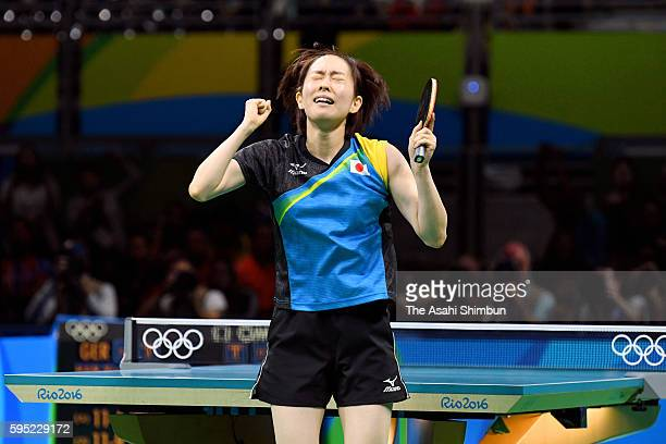 Kasumi Ishikawa of Japan celebrates a point against Han Ying of Germany in the Women's Team Semifinal between Japan and Germany on Day 9 of the Rio...